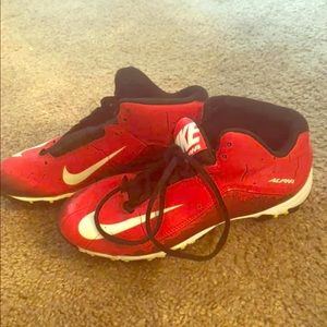 Red Nike cleats shoes